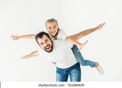 happy father piggybacking cute little daughter isolated on white