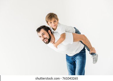 happy father piggybacking cute little son isolated on white