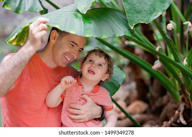 Happy father playing with little son