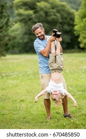 Happy father plays with son in the park as a fun family