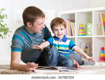 happy father reading a book to child boy indoor