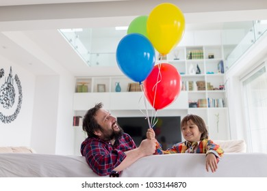Happy father and son with balloons