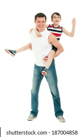 Happy father and son having fun riding on the back isolated on white