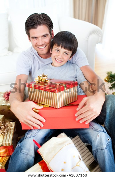Happy Father Son Holding Christmas Gifts Stock Photo (Edit