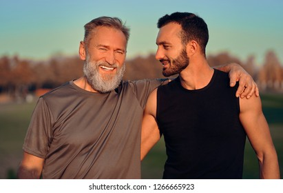 The happy father and son hug outdoor