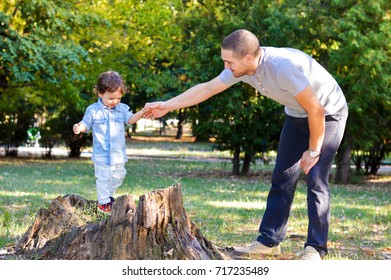 Happy father and son playing in the park