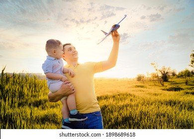 happy father with son playing with toy plane. dream to be a pilot.