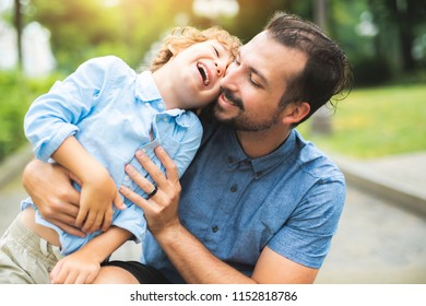 Happy father and son portrait playing together having fun