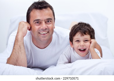Happy father and son relaxing - laughing with joy