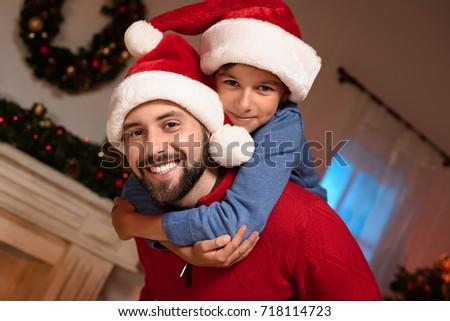 0e1799d0e58ba Happy Father Son Santa Hats Hugging Stock Photo (Edit Now) 718114723 ...