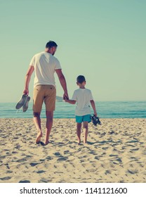 Happy father and son spend time together on the beach.