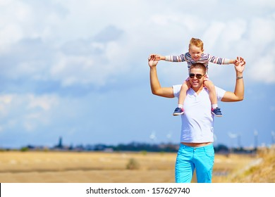 happy father and son in summer day