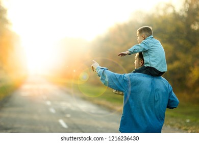 happy father and son walk in nature