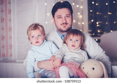 Happy father with twin kids boy and girl