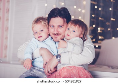 Happy father with twins boy and girl