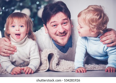 Happy father with twins kids boy and girl