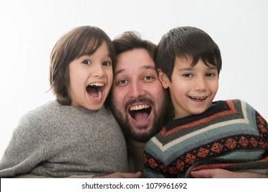 Happy Father with two sons Portrait