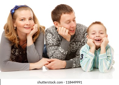 Happy Father,Mother and Son Lying, on the White Background.They Dressed in Similar Warm Clothes