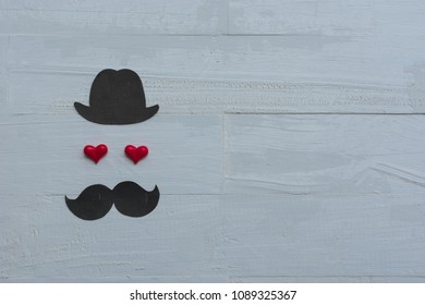 Happy Fathers day background card. black sign of hat, mustache and pipe with two red heart - eyes.