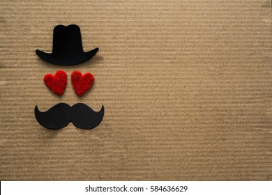 Happy Father's day background or card. black sign of hat, mustache and pipe with two red heart - eyes. empty copy space for inscription.