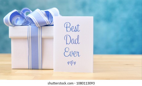 Happy Father's Day close up of Best Dad Ever greeting card and gift with copy space.