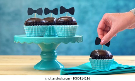 Happy Father's Day close up of chocolate cupcakes on cake stand on table.
