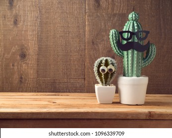 Happy Fathers day concept with two cactus decor as father and son over wooden background