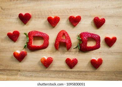 Happy Father's Day conceptual image with DAD inscription with strawberry and hearts.