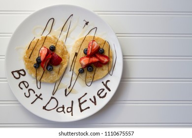 Happy Father's Day conceptual image with pancakes and fruits on white plate with white background. With copy space.