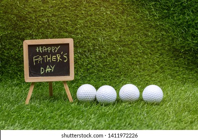 Happy Father's Day with golf ball on green grass
