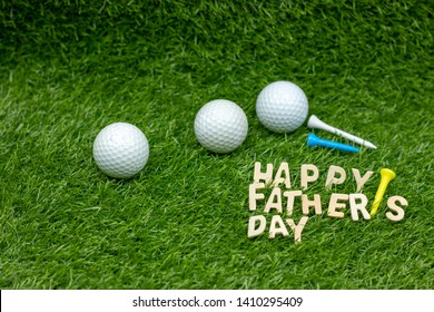 Happy Father's Day to golfer with golf balls and tees are on green grass