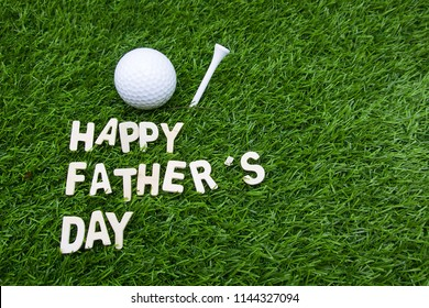 Happy Father's day to golfer word is on green grass with golf ball