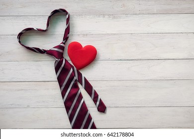 Happy Father's Day inscription with colorful tie and watch on wooden background floor background.