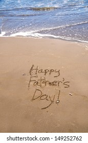 """""""Happy Father's Day,"""" a message in the sand"""