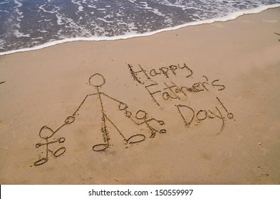 """""""happy fathers day,"""" a message written in the sand at the beach"""