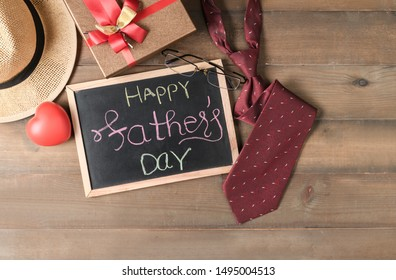 Happy Father's day on blackbroad with accessories dad on wood background, love Father's day concept