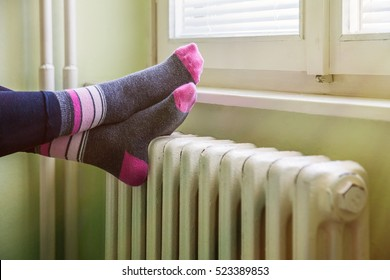 happy feet resting on the white, warm radiator