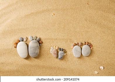 Happy feet. Stone arranged like a footprint on the beach