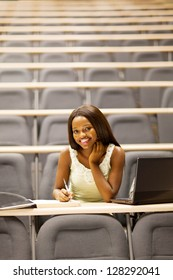 happy female african college student in lecture room