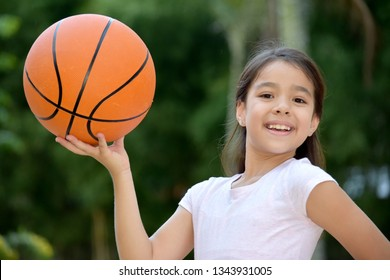 Happy Female Athlete Child Basketball Player With Basketball