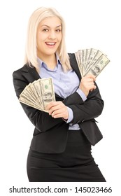 Happy female in black suit holding US dollars isolated on white background