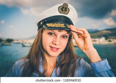 Happy female captain with sailor cap - marine concept - retro style