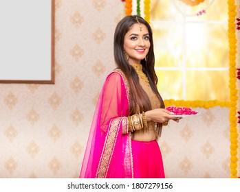 Happy Female Celebrating Diwali. Carrying Pooja Thali in hand
