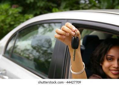 happy female driver showing car keys