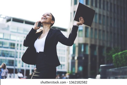 Happy female entrepreneur celebrating success feeling excited after received good news about deal with business partners while calling via cellphone, concept of triumph, achievement and victory