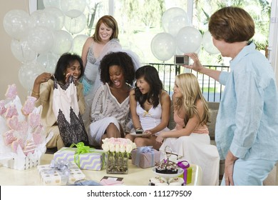 Happy female friends celebrating party together