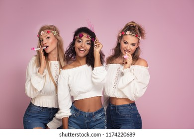Happy female friends having fun together. Three young women posing and laughing, copy space.