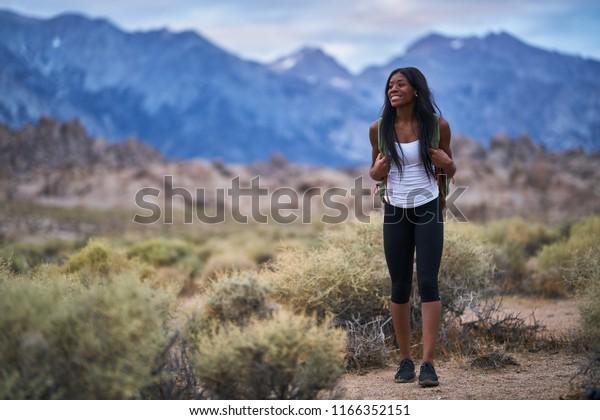 happy female hiker at alabama hills park