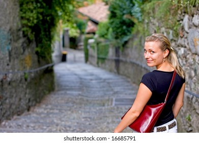 happy female looking back while walking down romantic stairs