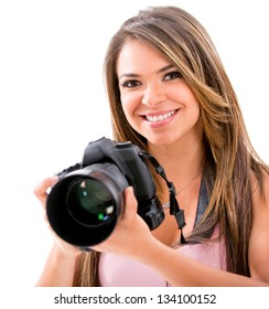 Happy female photographer with a camera - isolated over white